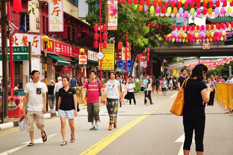 享受中间秋天节日的人群在香港 免版税库存图片