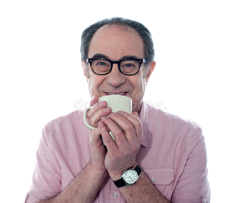 享受人高级微笑的咖啡 库存图片