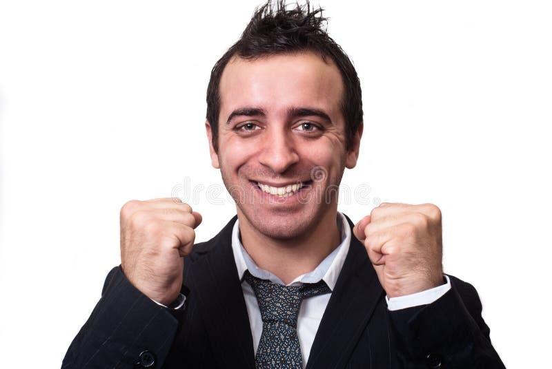 享受成功的年轻商人隔绝在白色 库存图片