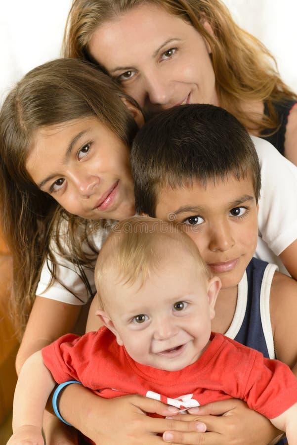 享受统一性的愉快的家庭 免版税图库摄影