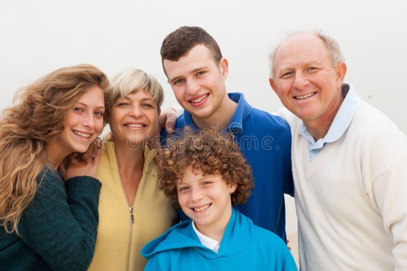 享受他们的假期的家庭 图库摄影