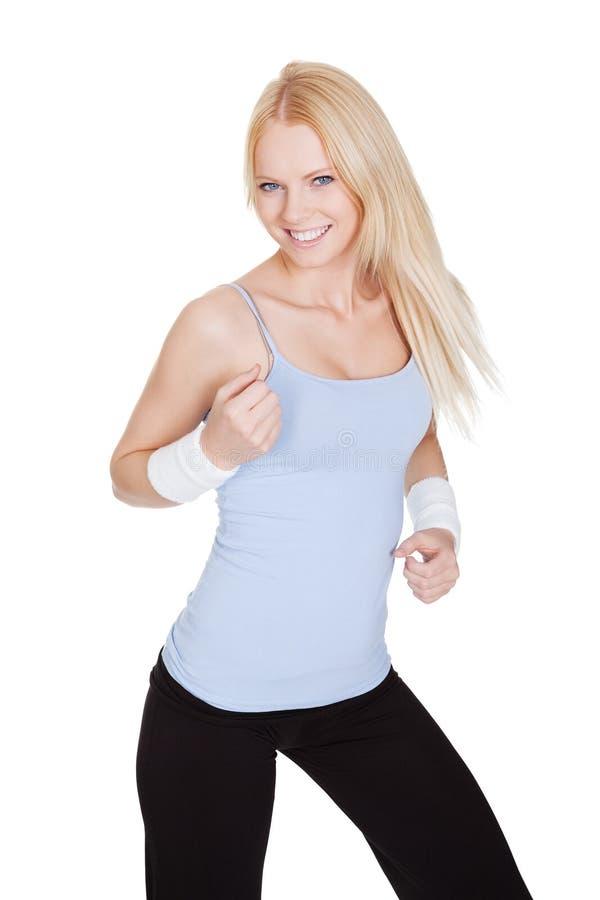 享受Zumba健身的美丽的妇女 免版税图库摄影