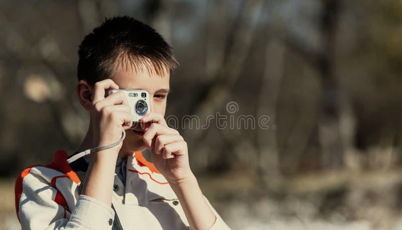 享用五本质老摄影师拍摄需要年 库存图片
