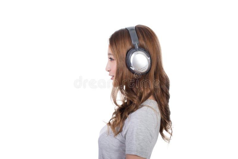 享用音乐妇女 免版税库存照片