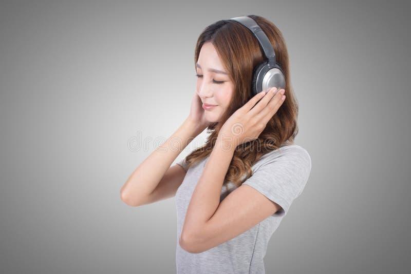 享用音乐妇女 库存照片