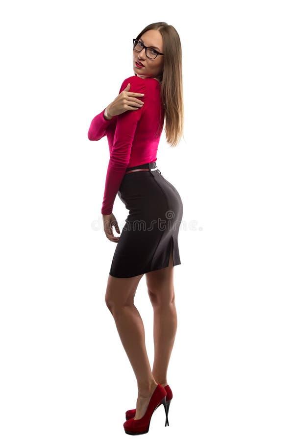 亭亭玉立的少妇的图象红色衬衣的 库存照片