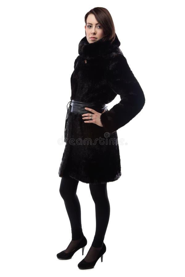亭亭玉立的浅黑肤色的男人的图象皮大衣的 库存图片