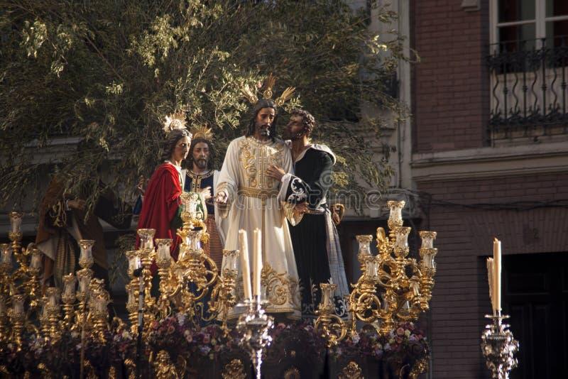 亲吻Judas,圣周的团体在塞维利亚,西班牙 免版税库存照片