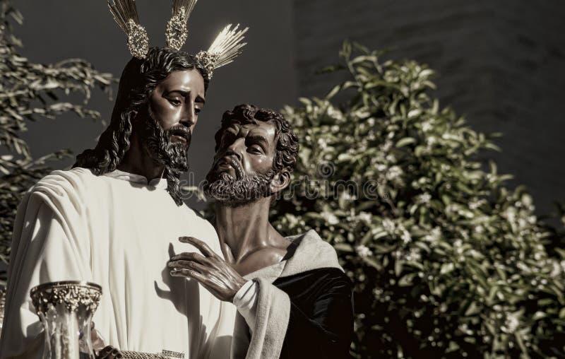 亲吻Judas,圣周的团体在塞维利亚,西班牙 免版税图库摄影