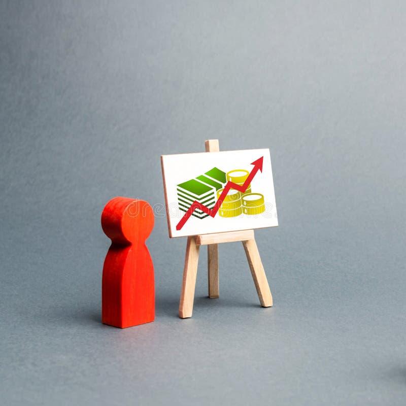 人举行一个介绍对人在简报,关于经营战略的讨论人群  对结果的分析 图库摄影
