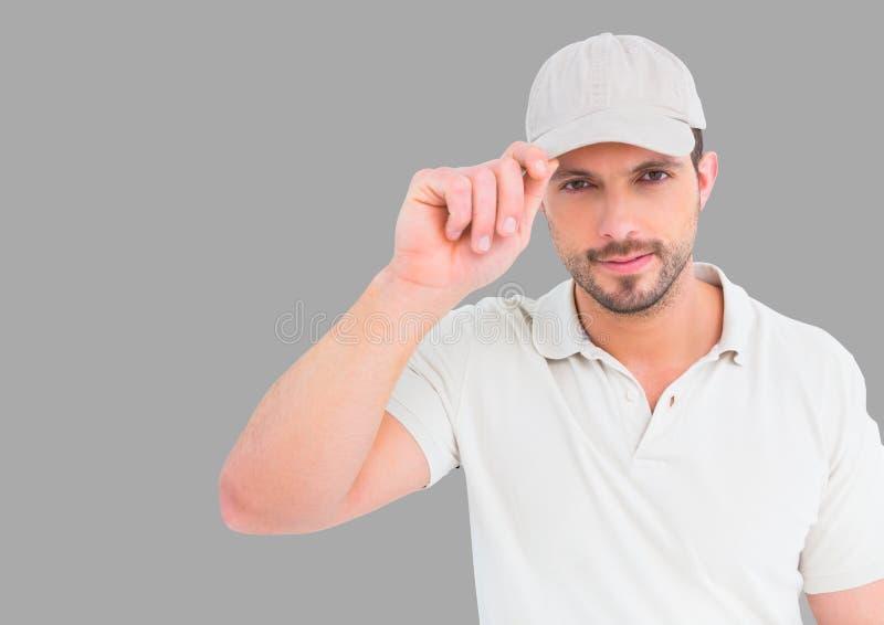人佩带的盖帽画象有灰色背景 图库摄影