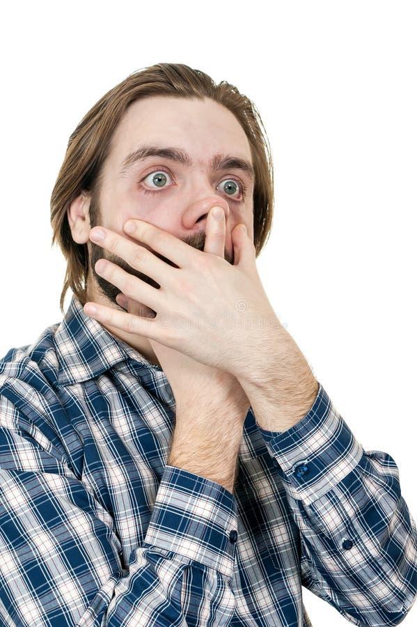 年轻人做可笑面孔 免版税库存照片