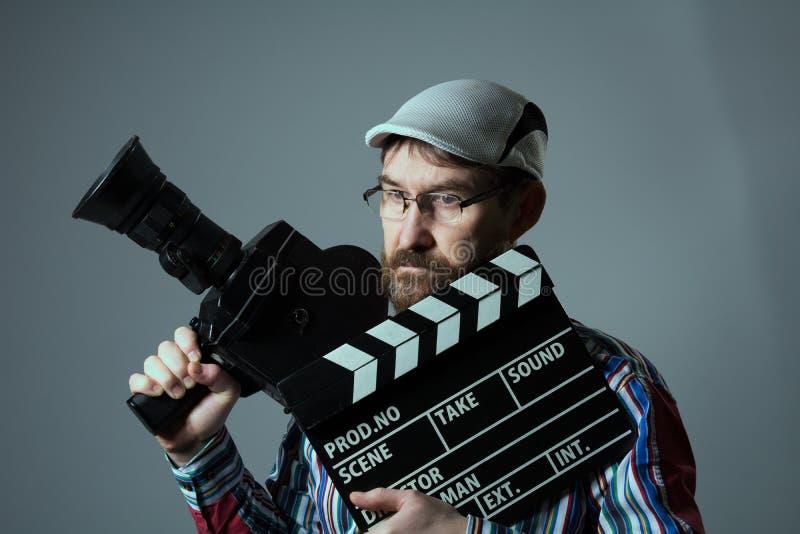 人减速火箭的电影摄影机和拍板 库存图片