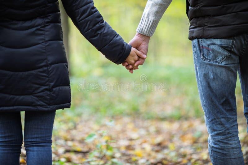 人和女孩握手 库存图片