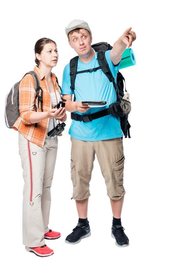 人和妇女旅行选上的路线与背包的 免版税库存照片