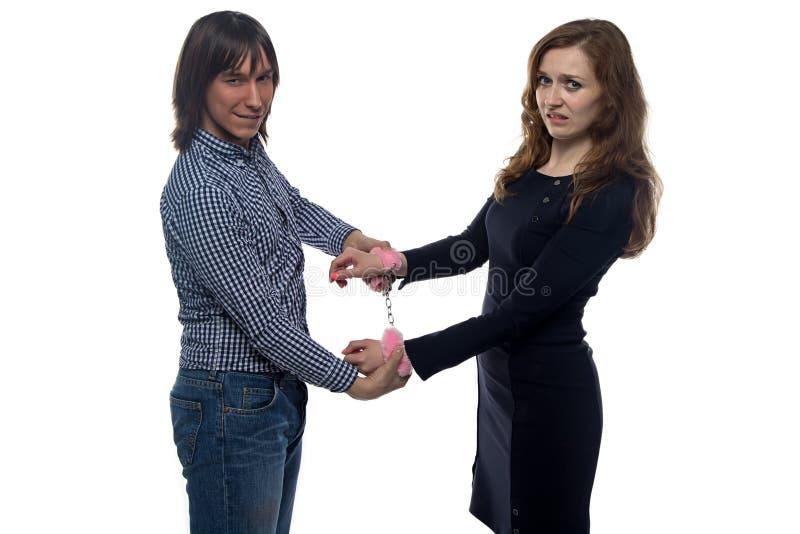 Download 年轻人和妇女有对的手铐 库存图片. 图片 包括有 情感, 人们, brunhilda, 格子花呢披肩, 空白 - 59112923