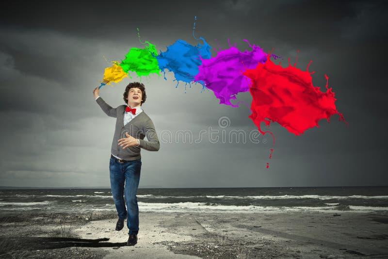 年轻人和颜色飞溅 图库摄影