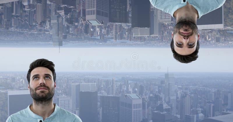 人和颠倒的城市的数字式综合图象 免版税库存照片