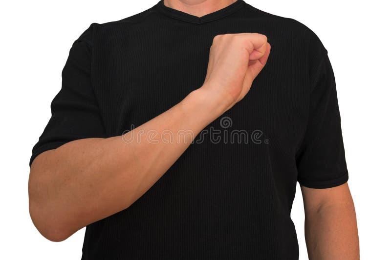 人在与人拳头姿态的心脏附近保留在乳房的胳膊在黑T恤杉隔绝没有面孔 强健的概念和 免版税库存照片