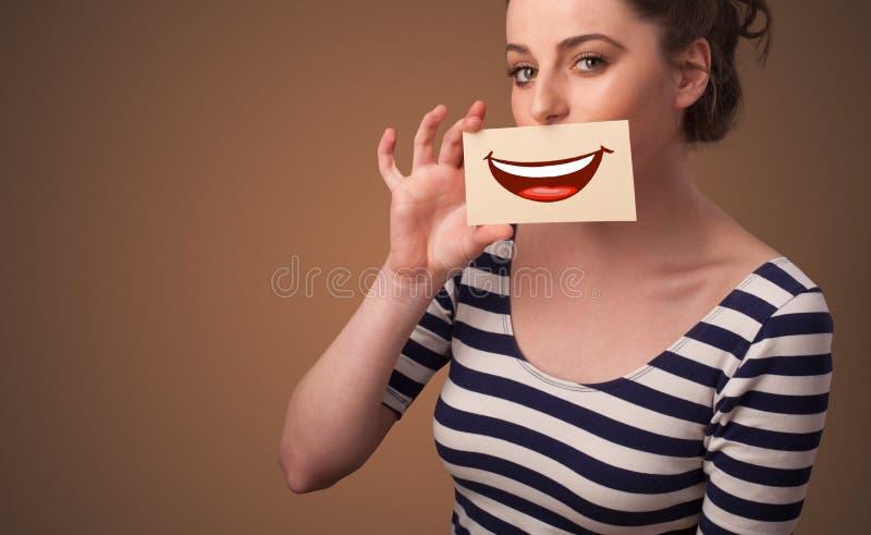 人在他的嘴前面的藏品卡片 库存照片