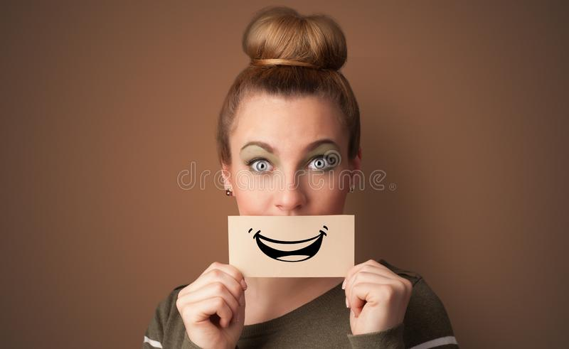 人在他的嘴前面的藏品卡片 库存图片