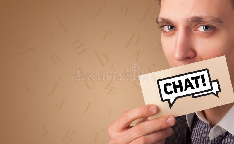 人在他的嘴前面的藏品卡片 免版税图库摄影