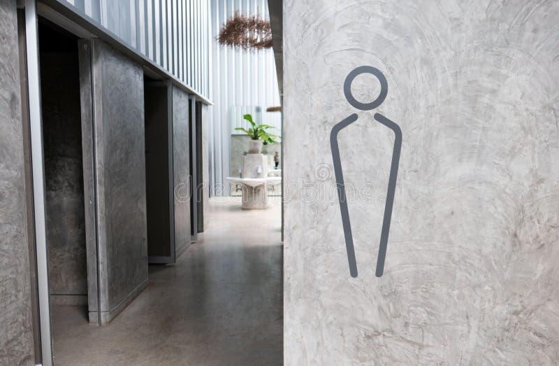 人在灰色墙壁背景的洗手间标志和拷贝空间、空间文本的或图象 库存例证