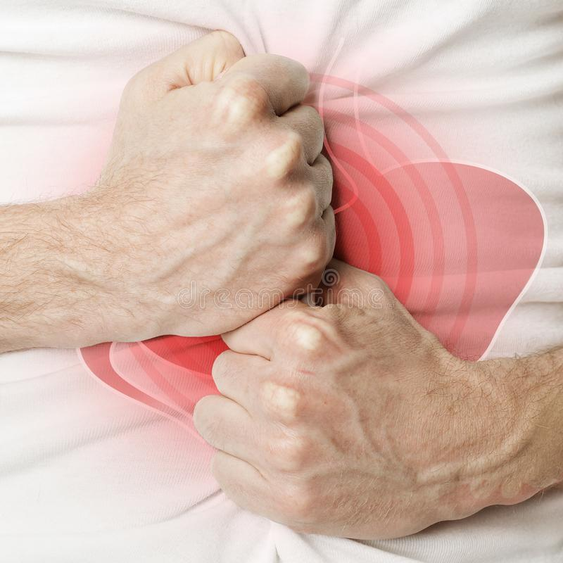 人在痛苦或消化不良中的握他的胃 库存图片