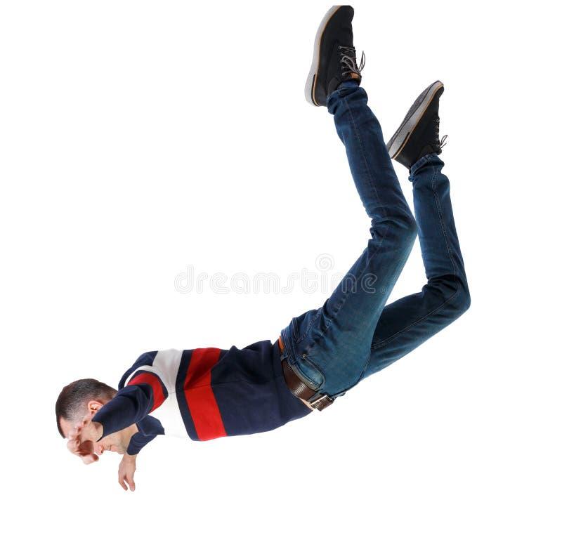 人在零重力或坠落时的侧视。人在零重力或坠落时的侧视。这家伙在空中飞,坠落或漂浮。侧面查ç 库存照片