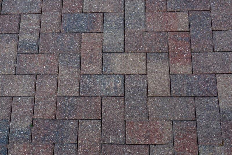人字形砖摊铺机边路背景 库存照片