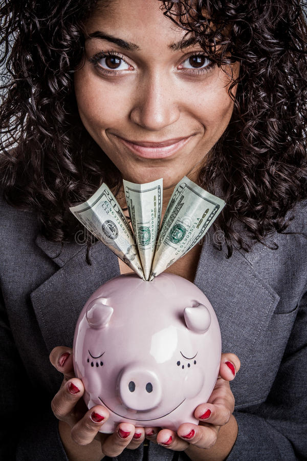 黑人存钱罐妇女 库存图片