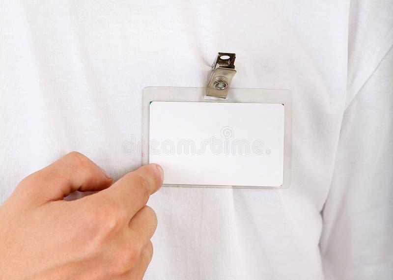 人展示他的徽章 免版税库存照片