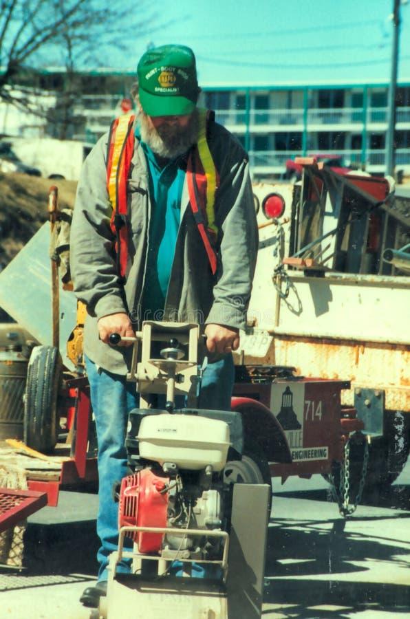 人工作在冬时 库存图片