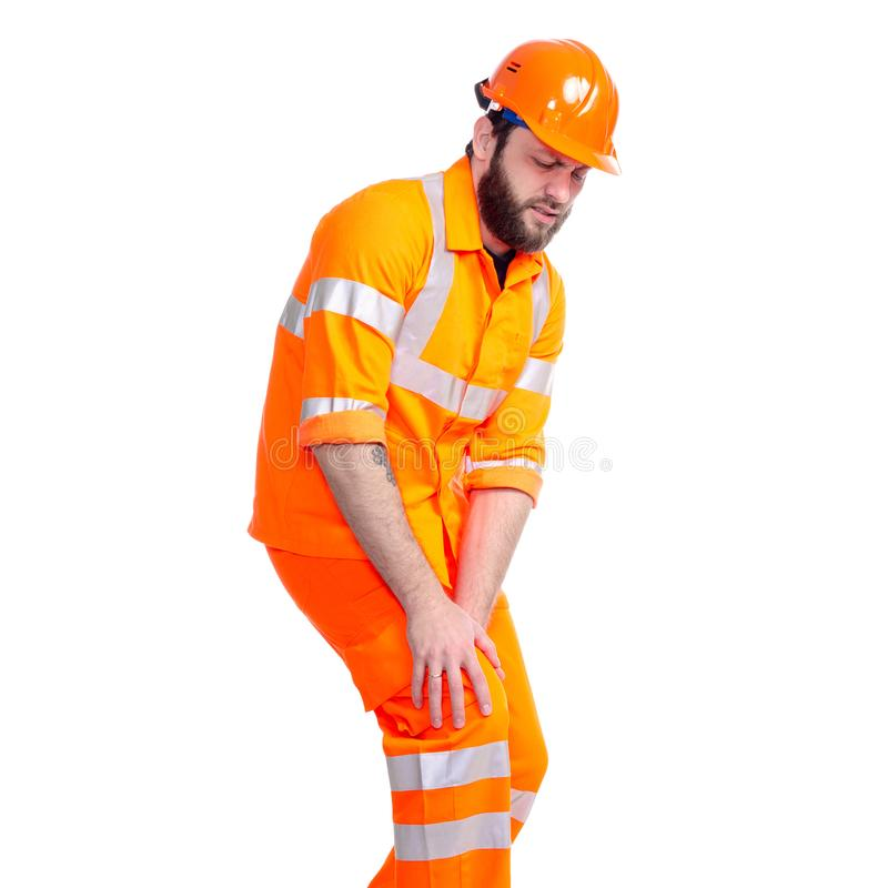 人工作者路建设者腿膝盖损害疼痛 免版税库存照片