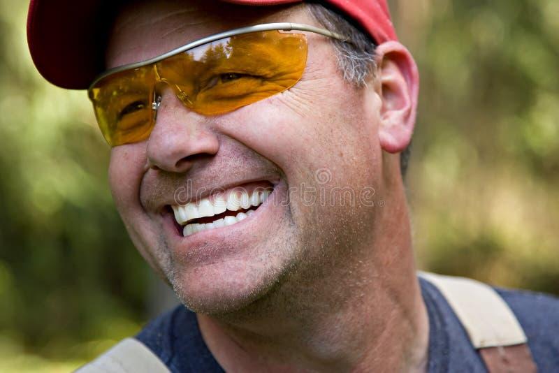 人微笑的工作者 免版税库存图片