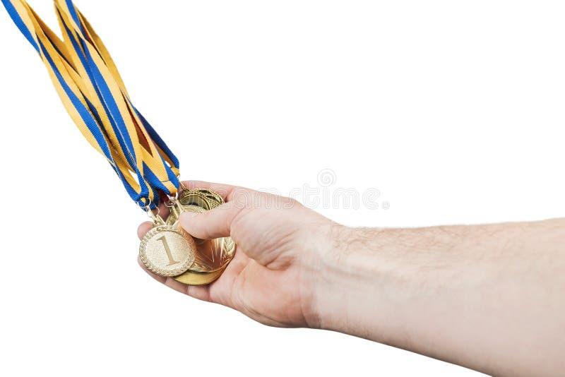 人手拿着奖牌 库存照片