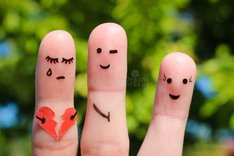 人手指艺术  有妇女的人调情的人 其他女孩拿着伤心 免版税库存图片