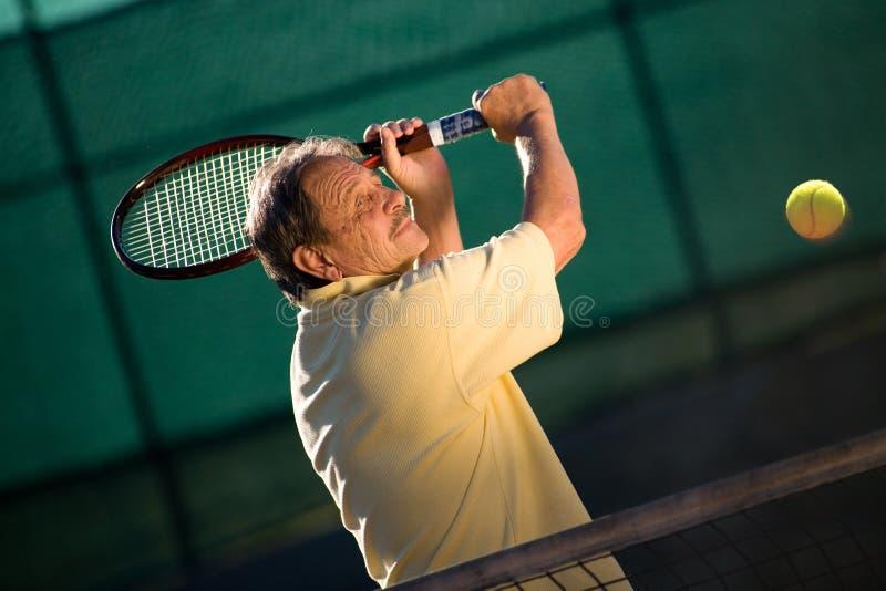 人打高级网球 免版税图库摄影