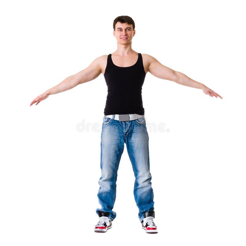 年轻人打破显示他的在白色的舞蹈家技能 库存图片