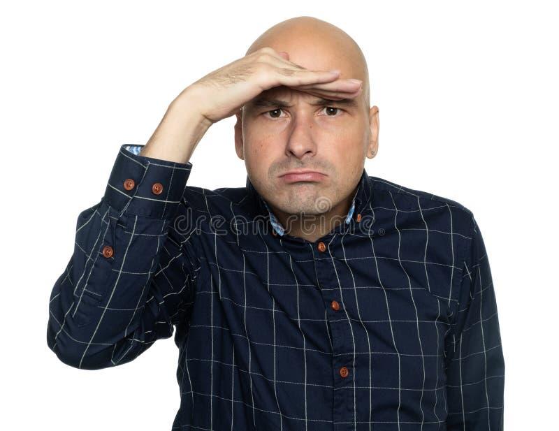人握在他的前额前面的手 免版税库存图片
