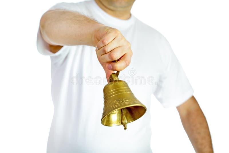 人敲响的响铃 免版税库存图片