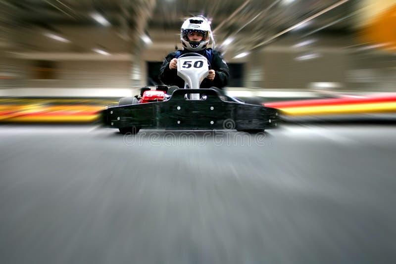 人是在karting的轨道的去kart 免版税图库摄影
