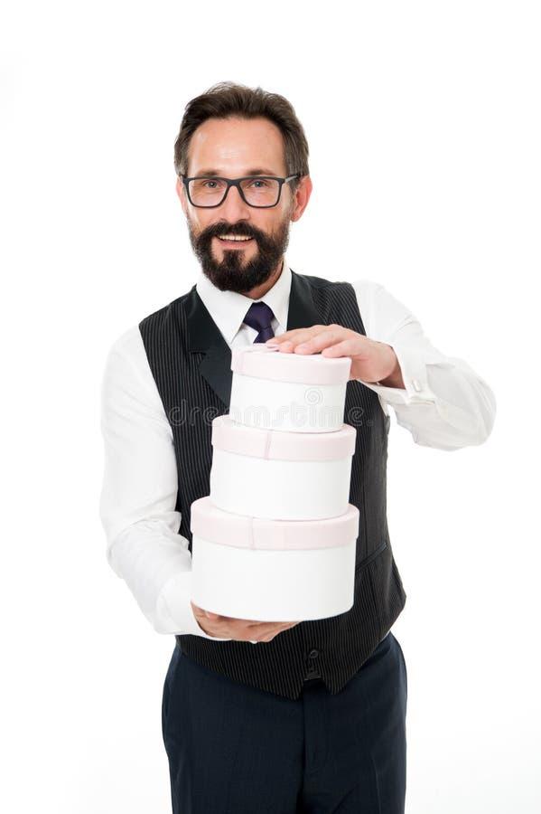 人正装拿着堆礼物盒 忠诚奖金概念 忠诚奖励节目 方式促进您的忠诚 免版税库存图片