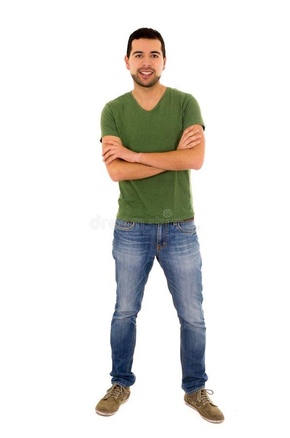 年轻人牛仔裤绿色T恤杉常设横穿 库存照片