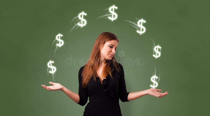 人玩杂耍与美元标志 免版税库存图片