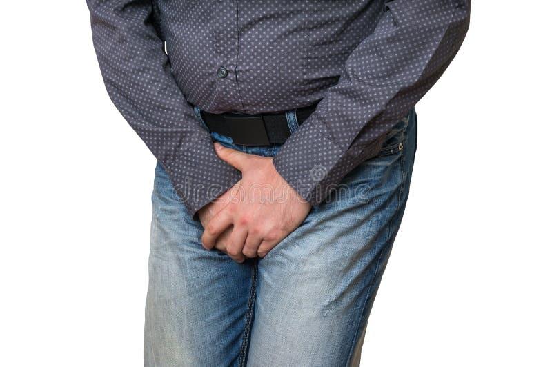 人用拿着他的裤裆的手,他要撒尿,无节制 免版税库存图片