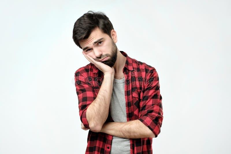 人用胡子在看起来的面颊的藏品手疲乏和病 库存图片