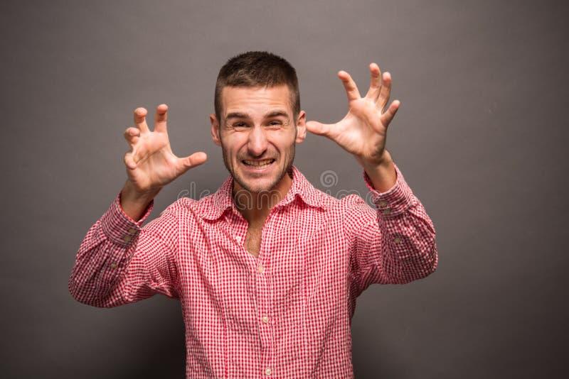 年轻人用他的在空气的手 免版税图库摄影