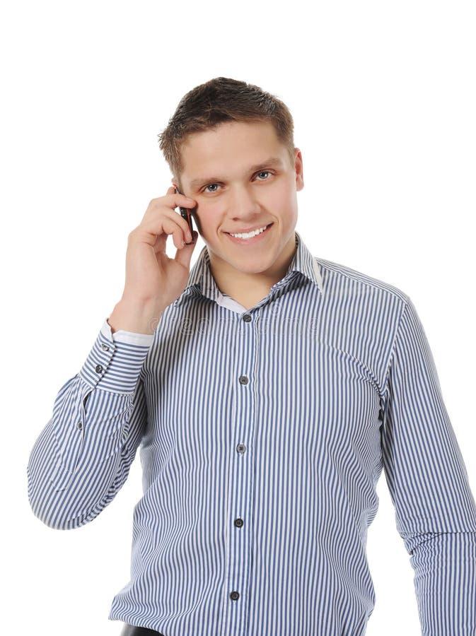 人电话微笑的联系的年轻人 库存图片