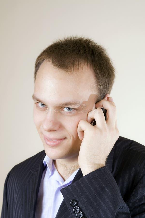 人电话满足的年轻人 库存图片